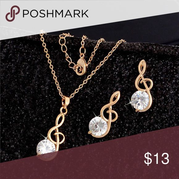 """MUSICAL CLEF NECKLACE & EARRINGS Gold tone necklace & earrings with rhinestone musical clefs. Earrings are 3/4"""" posts. Necklace is 16"""" with 2"""" extender. Very nice! fashion Jewelry Jewelry Necklaces"""