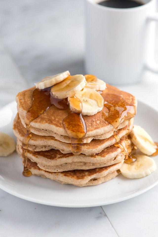 Easy Whole Wheat Pancakes Recipe made with whole wheat flour, butter or coconut oil, milk (dairy or non-dairy) and a touch of cinnamon. #pancakes #breakfast