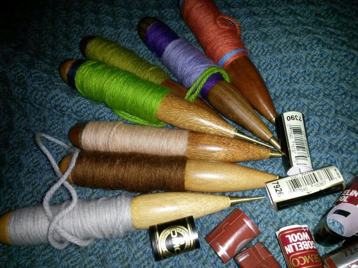 Winding bobbins using yarns from mixture of stash and just enough brought to keep it working.