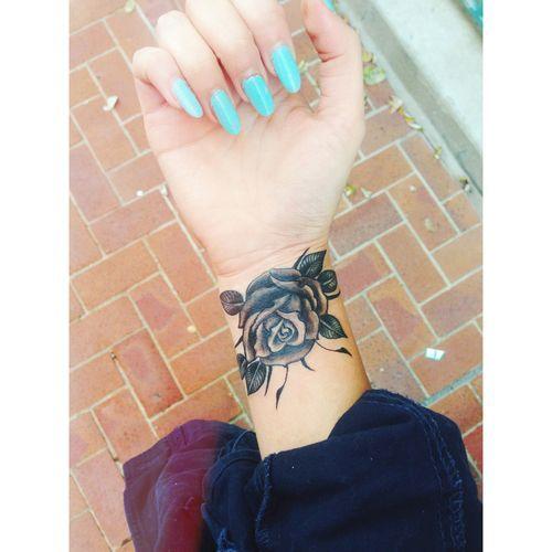 Rose tattoo on inner wrist
