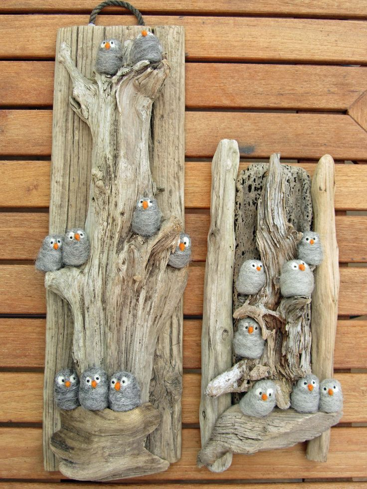 Pebbles painted in the image of owls or birds & glued to a piece of driftwood.