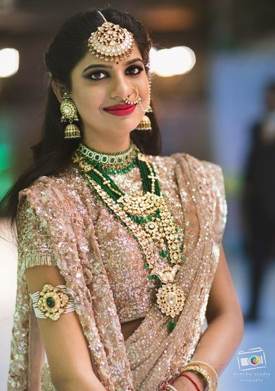 Indian Wedding Jewelry - Emerald and Polki Choker with Long Haar | WedMeGood #wedmegood #indianbride #indianwedding #jewelry #bridaljewelry #indianjewelry #emeralds #maangtikka