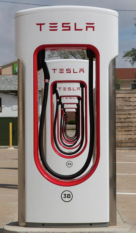 This creative image of six Tesla superchargers (a Tesla high power electric vehicle charging station) who were opened on St. Patrick's Day 2014, was photographed on site of the U-Drop Inn, also known as Tower Station and U-Drop Inn and Tower Cafe. It was built in 1936 in Shamrock, Texas along the historic Route 66 highway. Every photo is available as a Fine Art Print. Decorate your home or office with a high quality Canvas, Metal, Acrylic or Wood Print. Posters and matted and framed prints…