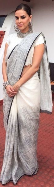 Neha Dhupia in a Grey and White Cotton Saree