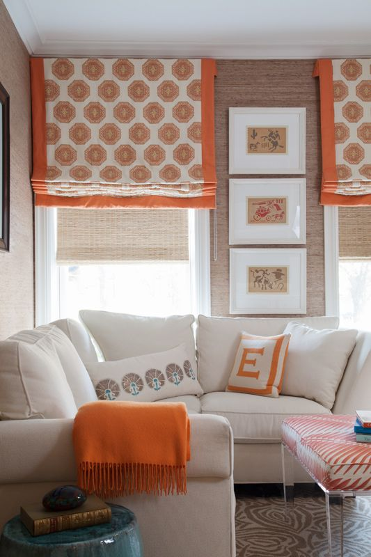 Colorful printed Roman blinds add a pop of color to this space that is picked up in other decorative accessories.