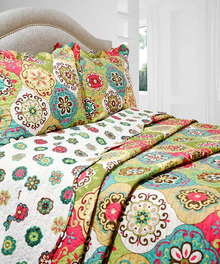 Topped with a vibrant pattern, this intricately stitched quilt set lends homespun charm to bedroom spaces. Soft microfiber construction feels luxurious to the touch, and the matching shams create a coordinated look. Includes quilt and two shams (twin sizes include one sham)100% polyesterMachine wash; tumble dryImported