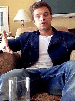 Sebastian Stan on a chair