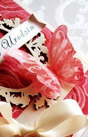 motyl ornamentowy mały i duży odbite tuszem ochra czerwona na kalce
