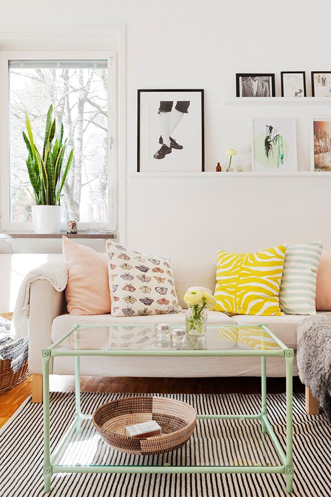 Love how textures and prints are combined here, especially on the sofa - so many accents, but great together. apartment of Swedish designer Elina Dahl