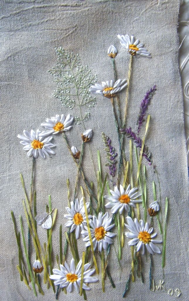 Hand embroidery: daisies and grasses