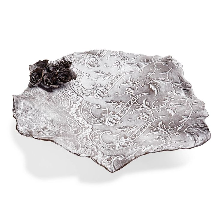 Made in the artist's Bordeaux studio, this ceramic dish with a sweet floral detail is hand-formed with natural, irregular edges and then stamped with lace to form beautiful, diminutive patterns. Created from the most delicate Bisque - unglazed baked porcelain - each Valerie Casado creation is inspired by everyday objects (buttons, lace, wildflowers) that bring a touch of whimsical beauty into our lives.
