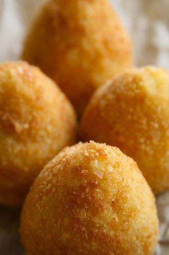 Sicilian Rice Balls by squidoo: Arancini are little oranges because that is what they resemble when they emerge from the fryer. Short grain rice is essential for this recipe, the balls of rice will not be glutinous without it, use a risotto rice.The shapes and fillings very over Sicily as a very very rough rule, the round arancini's are made with a meat sauce, pear shaped arancini's contain chicken and the oval are made with ham and cheese and a bechamel sauce... #Rice_Balls #Arancini…