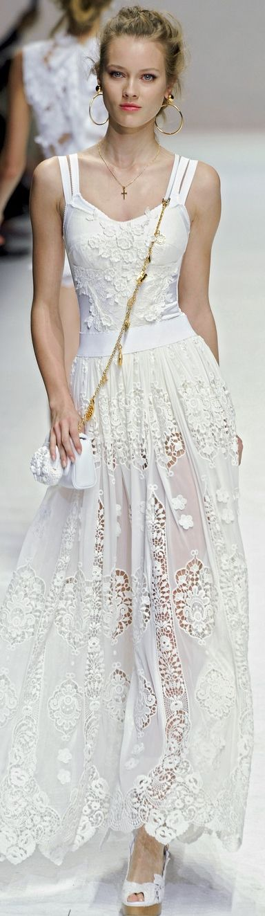 Dolce & Gabbana white cutout lace sleeveless dress   wedding gown   fitted corseted bodice and semi-sheer skirt