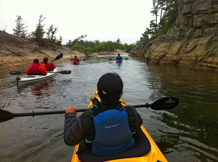 Kayaking through a channel with White Squall Paddling Centre in Parry Sound on Georgian Bay - http://redhunttravel.com