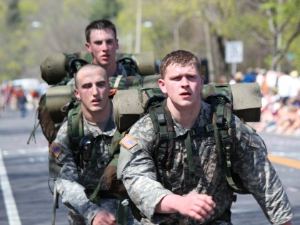 This sums up the real heroes of the Boston Marathon! Completed in full uniform. (Photo from WBZ Boston)