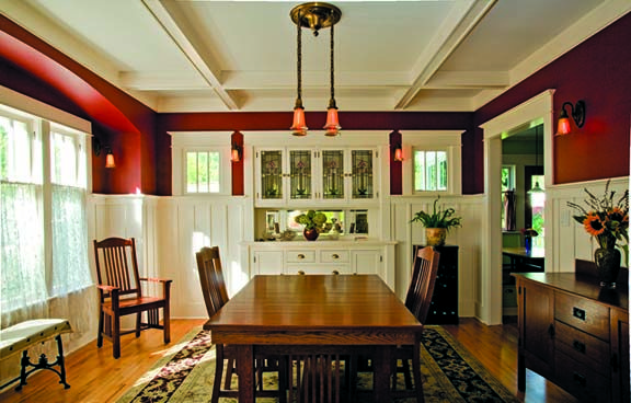 In the dining room, Tim uncovered ceiling beams once hidden, added wainscoting and era-appropriate trim, and created a delicate arch over the bay window.