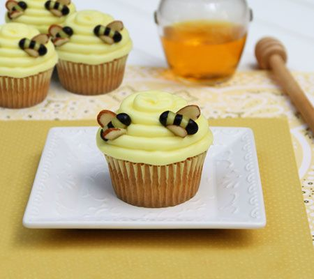 Pooh's Beehive Cupcakes. A baby shower inspired by Pooh Bear calls for a batch of sweet cupcakes decorated with lemon frosting hives and jelly bean bees.