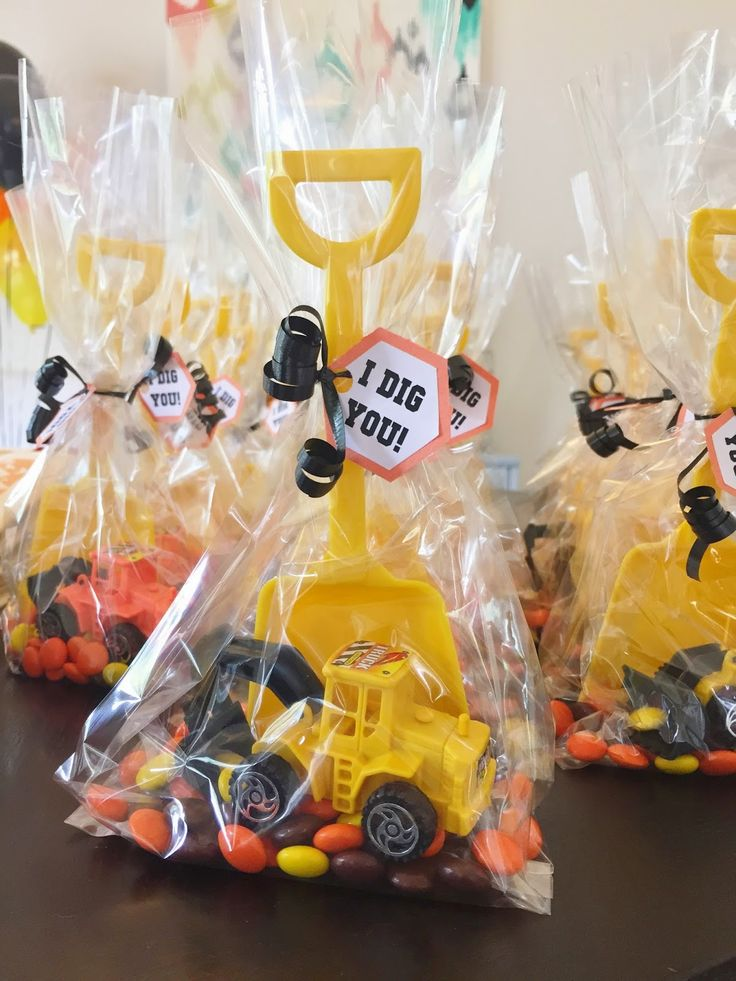 "Party favors for a construction-themed birthday party: Reese's Pieces, a toy mini construction vehicle, a yellow plastic shovel and an ""I Dig You!"" label.  See more photos, décor and DIY project details from this party at www.fabeveryday.com."