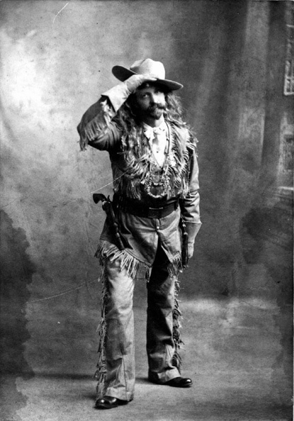 """Alfred Aaron Phelps in full buckskins at the Corn Carnival on October 19th, 1901 in Peoria, Illinois. Alfred was born on 14 Feb 1849 in Wataga, Knox, Illinois.  He acquired the nickname """"Squire"""" as he served as a judge for several years. He lived in Peoria, Illinois most of his life, and he rode in the Buffalo Bill's Wild West show for several years. Taken by Burk Studios in Peoria, Illinois."""