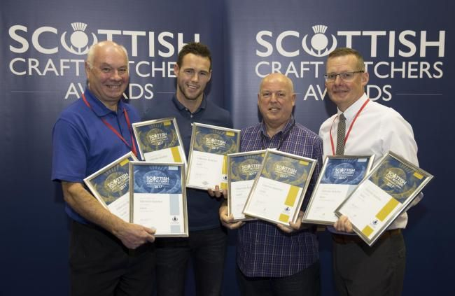 Gavin Colquhoun (centre left) and Brian Stewart from Elderslie Butchers receive their awards from Tom Lawn of Scobies Direct and Archie Hall from DalzielPicture by Graeme Hart