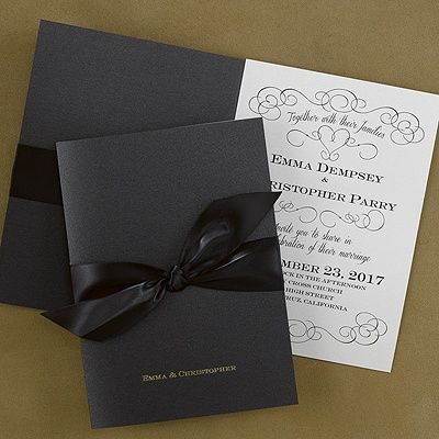 "Midnight Passion Black and White Invitations for your wedding. The wording ""Together with their families"", along with a lovely design, surrounds your wording on this ecru shimmer invitation and is enclosed with a black pocket wrap and satin ribbon.  Dimensions: 5 1/2"" x 7 3/4"" Folded• Price Includes: Printed invitation, wrap, pre-cut ribbon, glue dots, and blank double ecru envelopes  • Production Time: 2 Working Days • Customer Assembly Required"