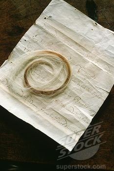 the lock of greying red hair preserved at Wilton, Queen Elizabeth I is said to have given to Philip Sidney in 1572 when she was thirty-nine