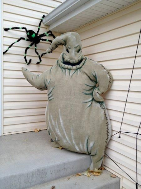 Amazing Oogie Boogie constructed out of burlap, glow in the dark paint and stuffed full of plastic grocery shopping bags.