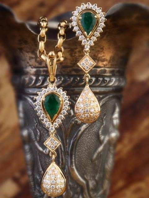 Emerald & Diamond Pendant set: Set of pendant and earrings is handcrafted in 18k gold and studded with diamond and emeralds.