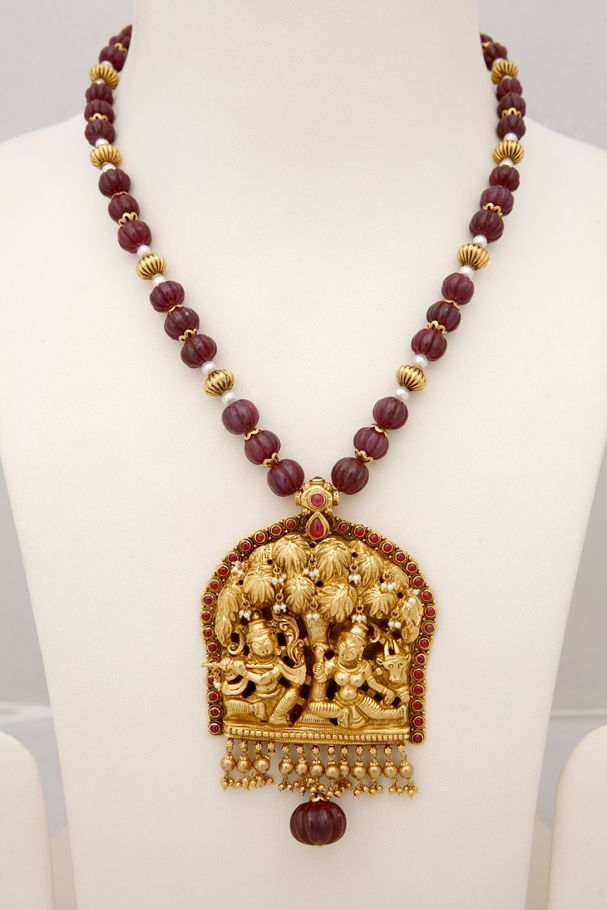 Radha and Lord krishna under a tree. Nakaash pendant with ruby beads and pearls.