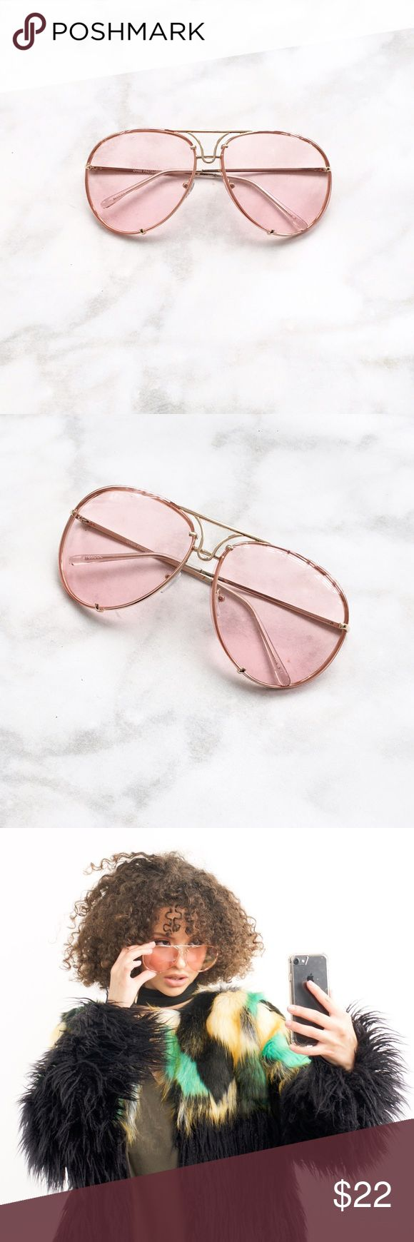 PINK LENS OVERSIZED AVIATOR SUNGLASSES ✨RESTOCK ALERT! PRICE FIRM!! Clear pink colored tinted lens Gold Trim Aviator style Oversized fit Approximate measurements:  Full width 5.75 in Individual lens size: 2.5in W, 2.25 in L Side bar 5.5 in.  THIS LISTING IS FOR 1 PINK OVERSIZED AVIATOR SUNGLASSES. Style Link Miami Accessories Sunglasses