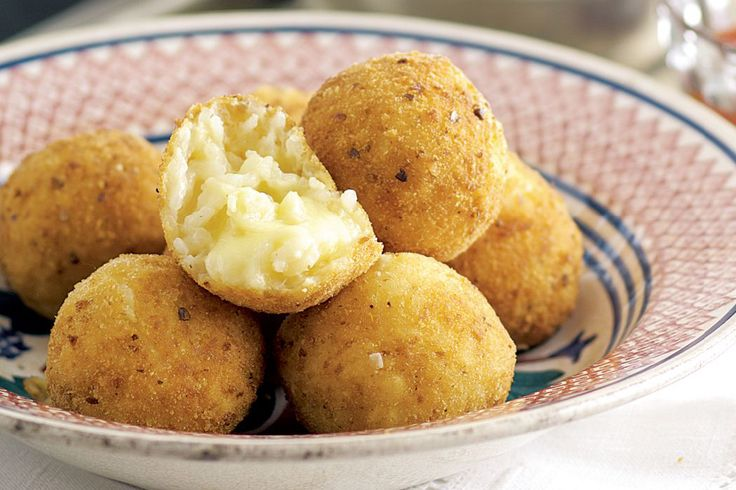 Coated in golden crumbs, each risotto ball holds a treasure of gooey mozzarella - no wonder they're a favourite Italian snack.