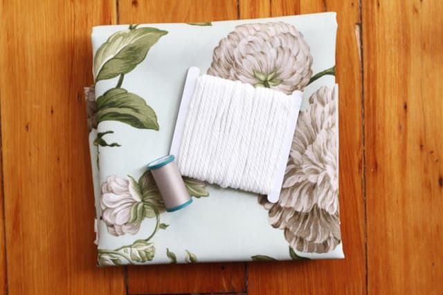 Check out this handy DIY for drawstring seat covers. They're easy to remove and wash, and can be changed out as often as you like throughout the seasons.