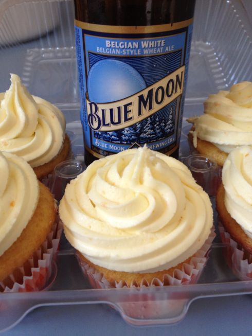 BLUE MOON CUPCAKES  These cupcakes start with a box mix. I recommend following the directions on the box, but substituting the amount of water called for with the same amount of beer. I used a Betty Crocker mix for these cupcakes and so I've listed the ingredients called for on the box. Other brands may differ slightly.  1 Box yellow cake mix  1 cup Blue Moon Ale  3 eggs  1/2 cup oil  grated peel from 1/2 orange