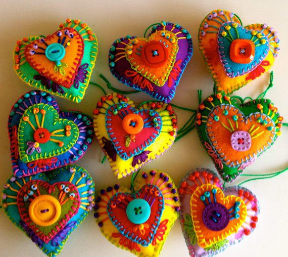 Folkloric style Christmas felt hearts are embroidered and beaded, complete with hanging tag and are available in a range of colour mixes. Each bauble is