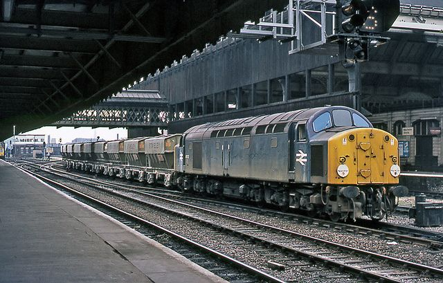 40122 is about to tackle the bank to Miles Platting with a Staveley stone train at Manchester Victoria on 24th June 1977.