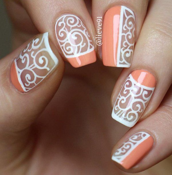 Creating patterns now is a trend among nail art designs. This ne has swirls on a clear base and then some solid nail polish for French tip, half moon designa nd some halfway blocks.