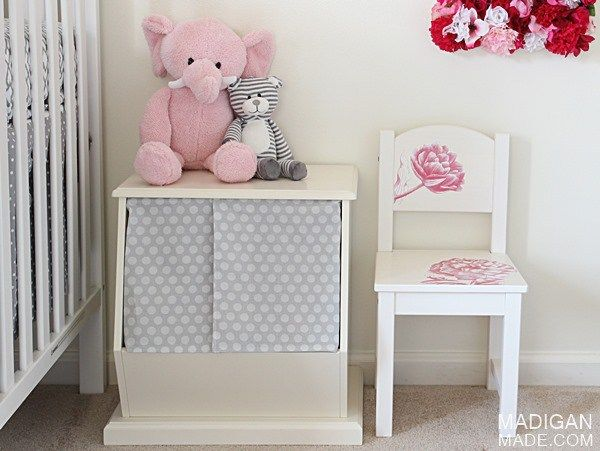 Baby girl nursery decor with toy storage and DIY chair update