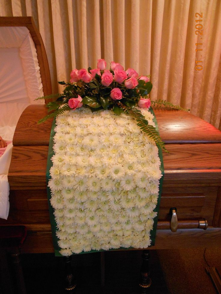 Unusual Casket spray in Pink and White