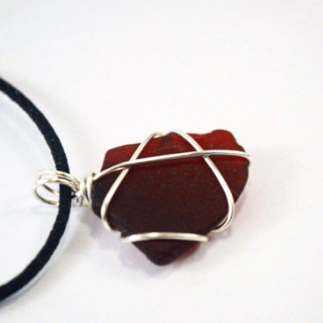 Ruby Red Sea Glass Necklace ~ Rare Red Texas Beach Glass ~ Wire Wrapped Black Silk Cord Necklace ~ Jewelry Present for Wife, Mother, Sister by GulfCoastTreasure on Etsy https://www.etsy.com/listing/255459395/ruby-red-sea-glass-necklace-rare-red