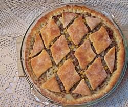 Ground Beef Biscuit Pie - Ground beef and vegetables in gravy served in a crust made from a biscuit baking mix.