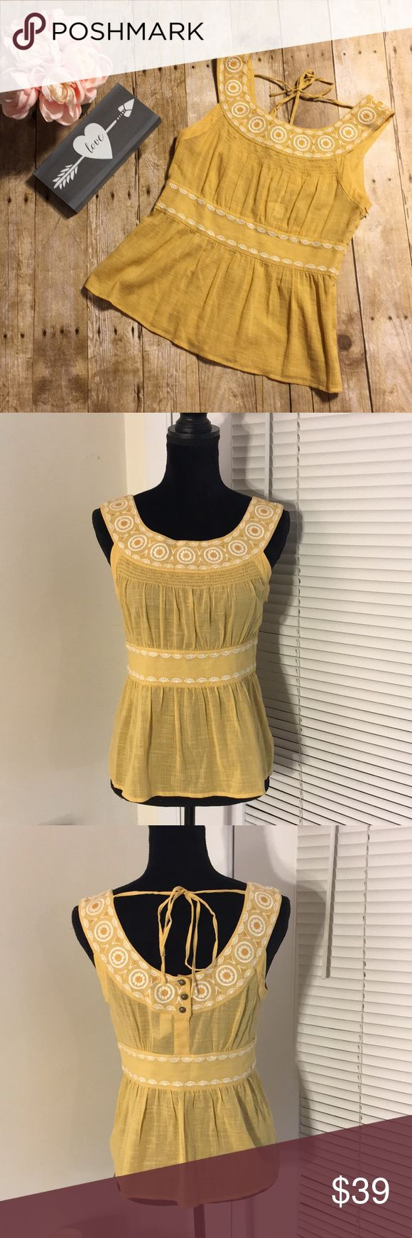 """Floreat Embroidered Tank (Anthropologie) Yellow cotton/linen blend tank from Floreat. Fabric has a slight crinkle texture to it. Embroidered pattern at the neckline and waist. Back of the top features and tie and three buttons at mid back. Fully functional concealed side zipper.   Approximate flat lay measurements  Bust: 15.5"""" Length: 22"""" Anthropologie Tops Blouses"""