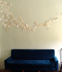 Many uses for coffee filters. Who knew! Wall art with coffee filters & cupcake liners!