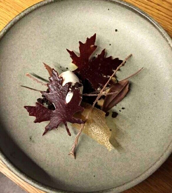 Blackberry leaves, glass pear, cinnamon twigs and poached pear