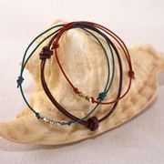The classic leather slip-knot bracelet is an accessory that you can make in less than five minutes, yet enjoy all summer long. Once you get the hang of it, the possibilities are unlimited for creating your own unique jewelry.