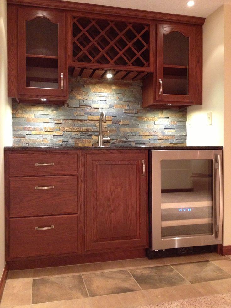 Wet Bar With Oak Cabinets And Stone Backsplash Stone