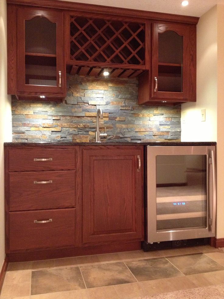 Wet Bar With Oak Cabinets And Stone Backsplash Hunters