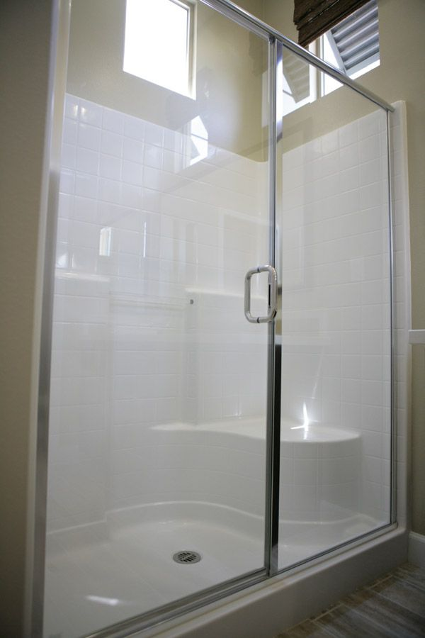 EASY MAINTENANCE MASTER SHOWERS - Master baths feature a comfortable fiberglass master shower that offers easy access with no grout, meaning easy maitenance to keep clean. #LyonVillas #newhomes