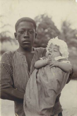 [African boy holding an european baby, in Gabon] :: International Mission Photography Archive, ca.1860-ca.1960
