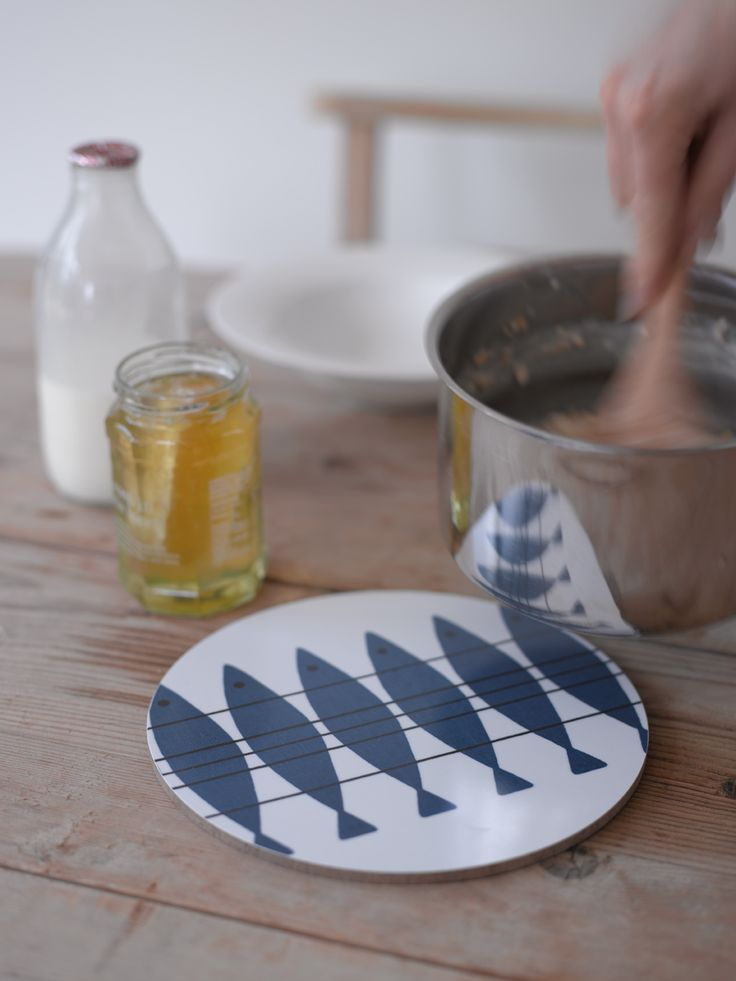 A trivet printed with Marianne Nilsson's 1950's herring pattern.  Made by the same family run business that make our trays… this trivet is lovely enough to use at the table – saving it from scorch marks.  21cm diameter. Available from www.newhousetextiles.co.uk