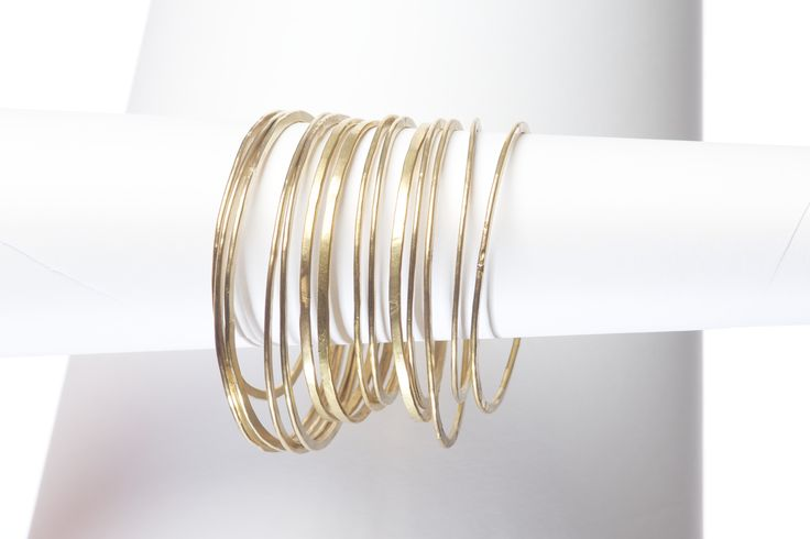 Re-claimed brass bangles made in Kenya by Sammy Semat and his team of artisans. www.onecolour.com